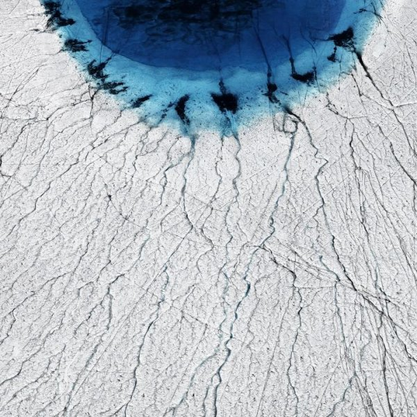 A surface lake in Greenland. A growing network of lakes on the Greenland ice sheet has been found to drain in a chain reaction that speeds up the flow of the ice sheet. Photo: Timo Lieber