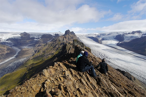 Hikers enjoying the view from Kristínartindar in Skaftafell